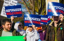 Refugees Welcome signs and people.jpg